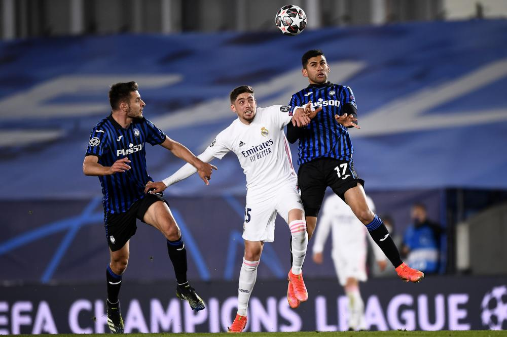 Madrid (Spagna) 16/03/2021 - Champions League / Real Madrid-Atalanta / foto Image Sport nella foto: Federico Valverde-Cristian Romero-Berat Djimsiti