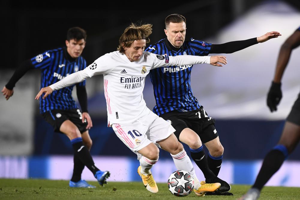 Madrid (Spagna) 16/03/2021 - Champions League / Real Madrid-Atalanta / foto Image Sport nella foto: Luka Modric-Josip Ilicic